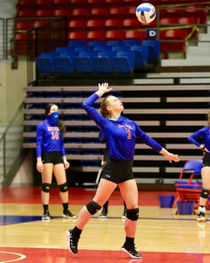 Hutchinson Community College's Shadee Briggs (7) serves the ball to Pratt during their match Thursday night at the Sports Arena.