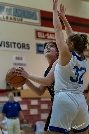 Inman's Raegan Neufeld (31) looks to shoot the ball past Independent School's Malgosia Byczkowska (32) during their game at the Sedgwick Invitational Tournament Thursday night. Inman lost to Independent 37-32.