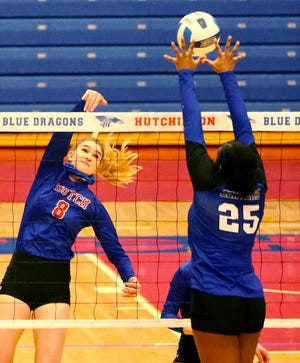 Hutchinson Community College's Shelby Murrell (8) spikes the ball to Pratt's Avery Smith (25) during their match Thursday night at the Sports Arena.