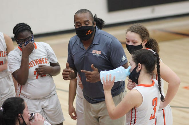 Southwest girls' basketball coach Chris Williams talks to his team during a timeout during the Stallions' 53-49 win over Richlands on Tuesday night. [Chris Miller / The Daily News]