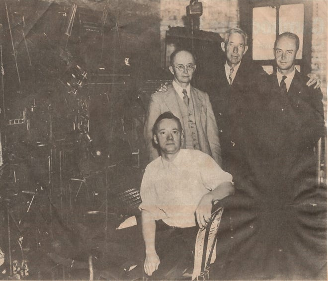 "Four Ledger pioneers, from left: A.J. Trueblood, composing foreman, seated at the newspaper's Linotype typesetting machine, which set lines of type from molten lead; Jay C. Smith, who in 1927 bought a substantial interest in the paper; Samuel Howard Farabee, founding editor and publisher; and A.W. ""Bud"" Smith, Jay's son and eventual heir to The Ledger."
