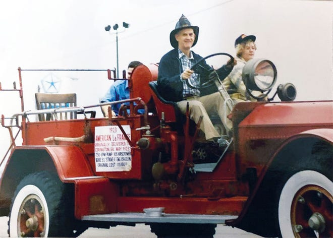 Tom Scott driving one of his vintage fire trucks.