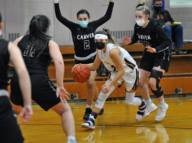 Notre Dame Academy's Ava Orlando of Westwood drives against Carver defenders from left, Megan Grimes, Havannah Pina and Madelyn Mueller during girls basketball at Notre Dame Academy in Hingham, Thursday, Jan. 28, 2021.