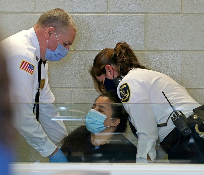 Christine Ricci, 46, of Marshfield, is brought into court and collapses as she is arraigned on charges of murder on Jan. 29, 2021 in Plymouth.