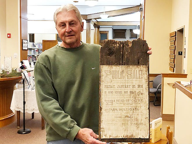 Wayne Kurth of Fairbury displays a sign which was discovered in Wisconsin about a Fairbury farm sale in 1905.