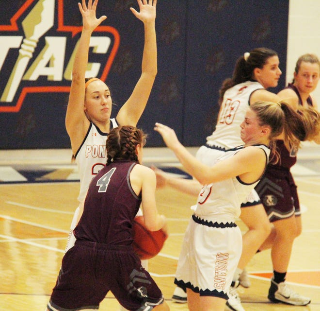 Pontiac seniors Addison Masching, left, and Alyssa Fox, right, shown here as juniors in a game last season, will get a chance to compete in basketball in their final prep season.