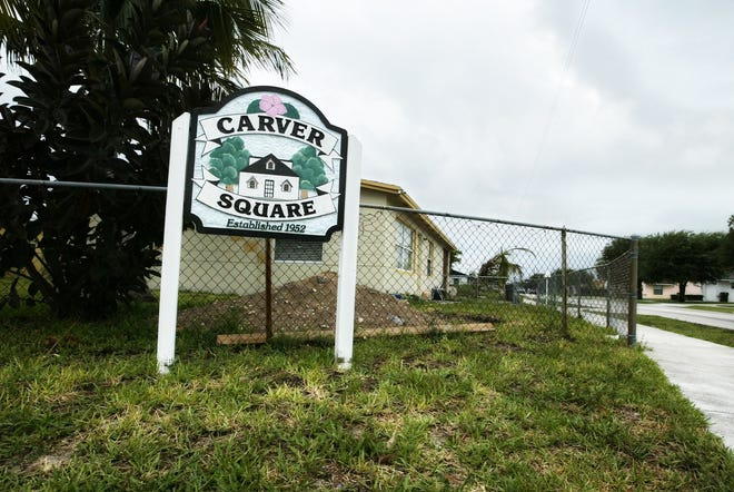 A sign at the corner of SW 2nd St. and SW 8th Ave. welcomes people to Carver Square.