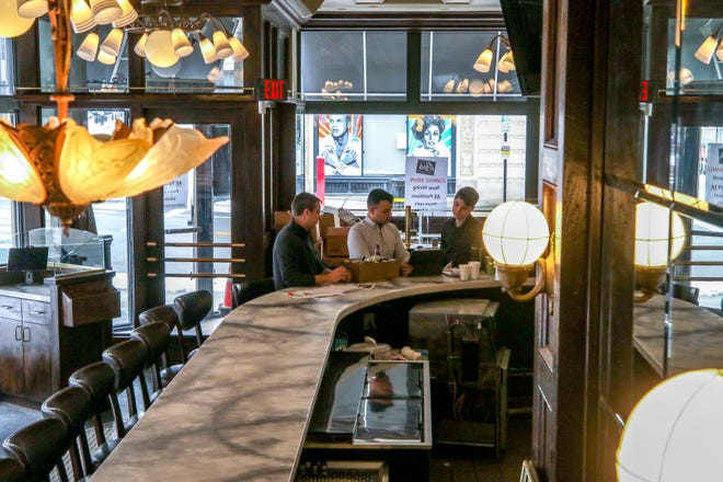 Seated at the first-floor bar at the corner of their soon-to-open restaurant are friends Stephen White, Evan Matthew and Ryan White-Cotton. Res American Bistro is across the street from Trinity Rep in Providence.
