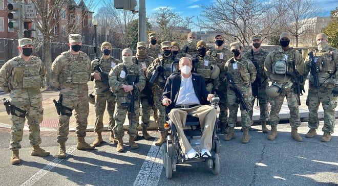 Congressman Jim Langevin with members of the Rhode Island National Guard still assigned to help protect the Capitol.