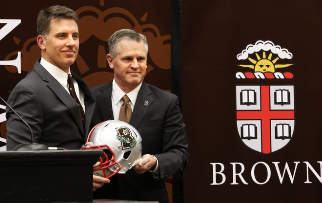 Jack Hayes, right, shown in 2018 announcing new football coach James Perry, is stepping down as Brown's director of athletics.