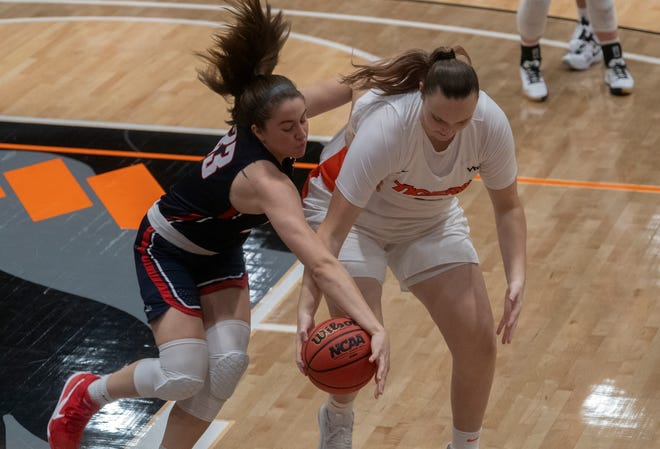 Gonzaga's Melody Kempton, left, fights for a loose ball with Pacific's Cassidy Johnson during a West Coast Conference women's basketball game at UOP's Spanos Center in Stockton. Gonzaga won 77-65.[CLIFFORD OTO/THE STOCKTON RECORD]