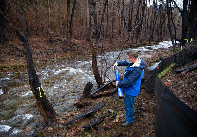 Karl Morgenstern, EWEB water quality supervisor, visits a stream in the a burn area of the Holiday Farm Fire during a tour of work being done to mitigate for damage to the environment by the fire.