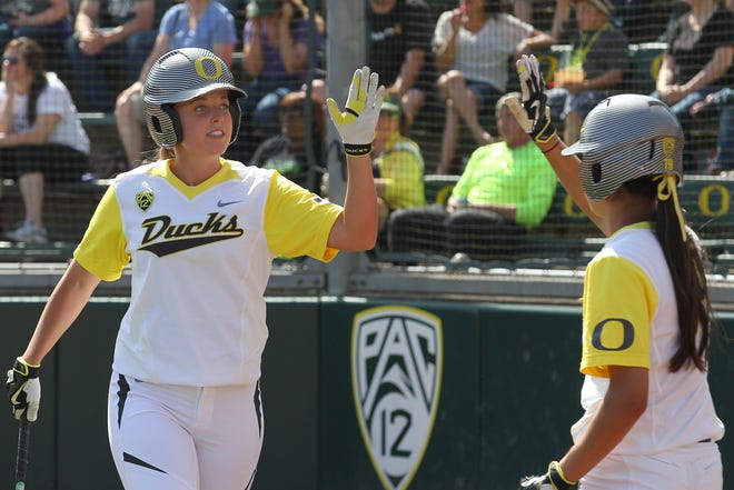 Former Oregon Ducks softball player Sara Goodrum, left, was promoted to minor league hitting coordinator by the Milwaukee Brewers on Thursday.