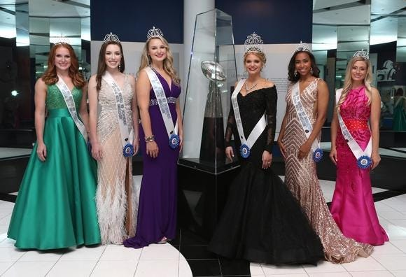 2019 Pro Football Hall of Fame Festival Queen Emma Kirkbride (four from left) poses for a group photo with her royal ambassadors and the Lombardi Trophy at the Pro Football Hall of Fame in June 2019. From left are Abbey Anderson, Maya Polen, Lainey Smith, Kirkbride, Haley Burns and Lauren Rhodes.