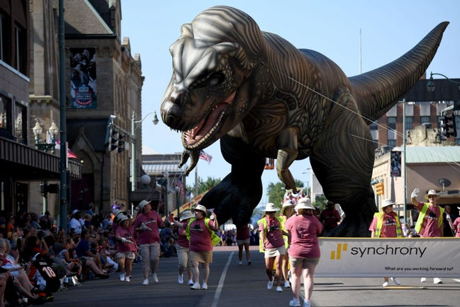 The T-Rex balloon in The 2019 Canton Repository Grand Parade Saturday,  Aug. 2, 2019.