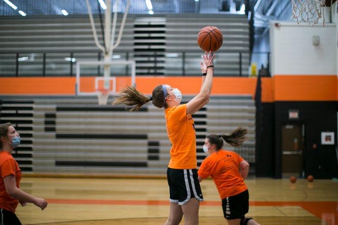 The girls basketball team practices at Winnebago High School on Friday in Winnebago.