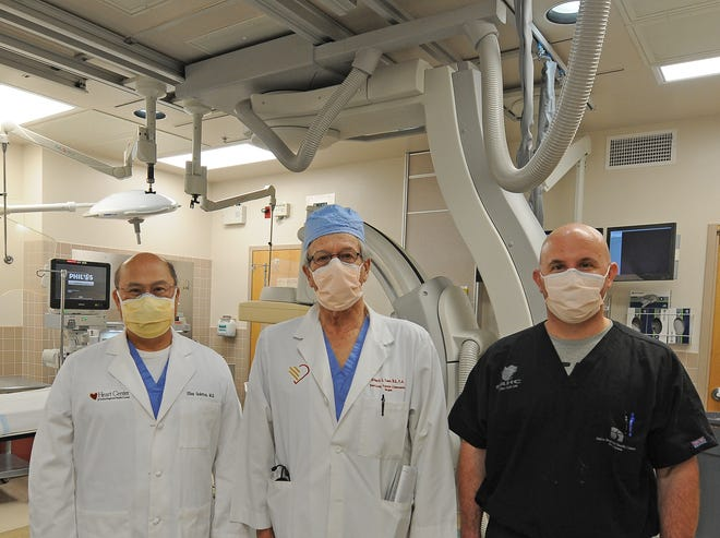 Cardiothoracic surgeons Elias Quintos and Richard Toon and cardiologist David Battin stand for a photograph after performing the first transcatheter aortic valve replacement (TAVR) surgery that was performed at the Salina Regional Health Center, with collaboration of Mowery Clinic on Tuesday.
