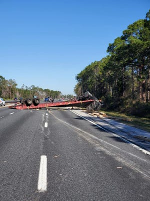 The scene of an overturned semi that crashed, backing up traffic on I-95 in St. Johns County Friday.