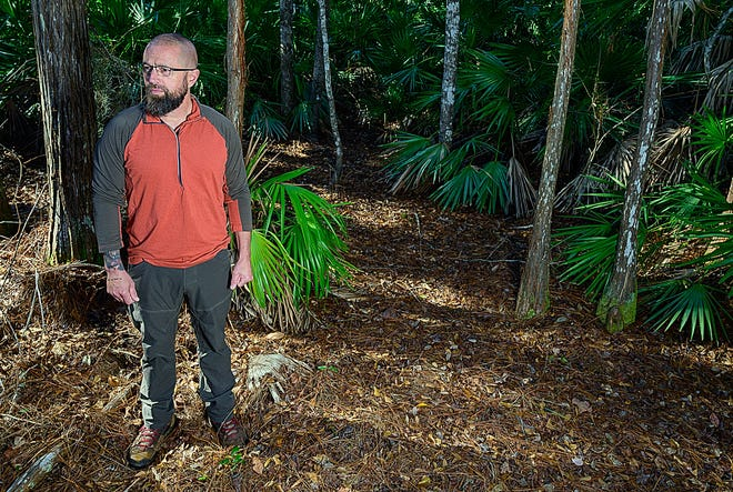 """St. Augustine resident and filmmaker Chris Simoes poses for a photograph in the woods behind his house on Thursday. Simoes wrote, edited, directed, produced and stars in a film available on Amazon Prime Video called """"Bigfoot: The Conspiracy."""""""