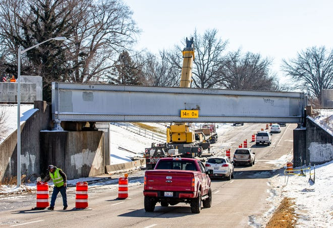Traffic heading south bunches up Friday underneath the Fifth Street railroad overpass in Springfield. Fifth Street from Broad Place to Iles Avenue temporarily closed at 7 p.m. Friday for the installation of a new railroad bridge as a part of the Springfield Rail Improvements Project.  [Justin L. Fowler/The State Journal-Register]
