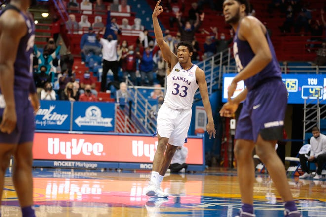 Kansas junior forward David McCormack celebrates a 3-pointer late in the second half of the Jayhawks' game against TCU on Thursday night at Allen Fieldhouse. McCormack's first career trey was the biggest make in an 11-1 run that powered No. 15-ranked KU to a 59-51 victory.