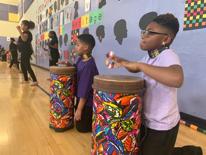 Ross Elementary students Reynaldo Rodriguez-Davila, left, and JaVonte Hollingsworth, right, perform on congas during the 2019 Celebrating Our Heritage all-school assembly.