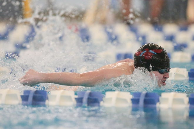 Shawnee Heights Luke Perkins swims to victory in the 200-yard IM with a time of 2:04.48 at Thursday's City Swim Meet at Capitol Federal Natatorium. Perkins also won the 500 freestyle and was on the T-Birds' winning 200 medley relay.