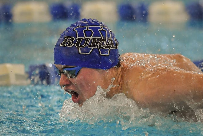 Washburn Rural's Nathen Trachta swims to the 100-yard butterfly title at Thursday's City Swim Meet at Capitol Federak Natatorium. Trachta also won the 100 backstroke, leading Rural to its second straight team title.