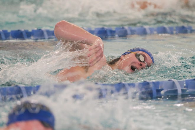 Yeager Larson, Washburn Rural senior, wins the 200-yard freestyle in 1:54.78 at Thursday's City Swim Meet at Capitol Federal Natatorium. Larson helped the Junior Blues run away with their second straight title