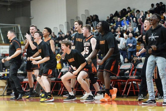 The Taunton bench erupts during the fourth quarter during 2020 Division I South sectional quarterfinal game at Brockton High School.