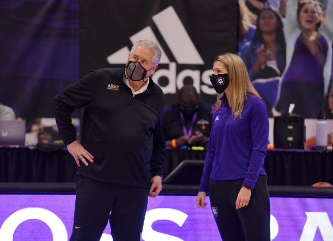 Army women's basketball coach Dave Magarity, left, talks with Holy Cross coach Maureen Magarity, his daughter, before a game earlier this month at the Hart Center.
