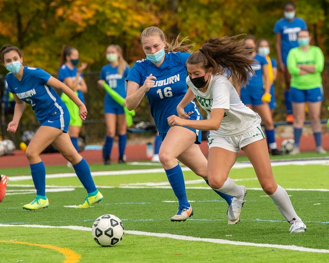Auburn's Ali McKiernan chases Sutton's Natalie Smith during a game last October.