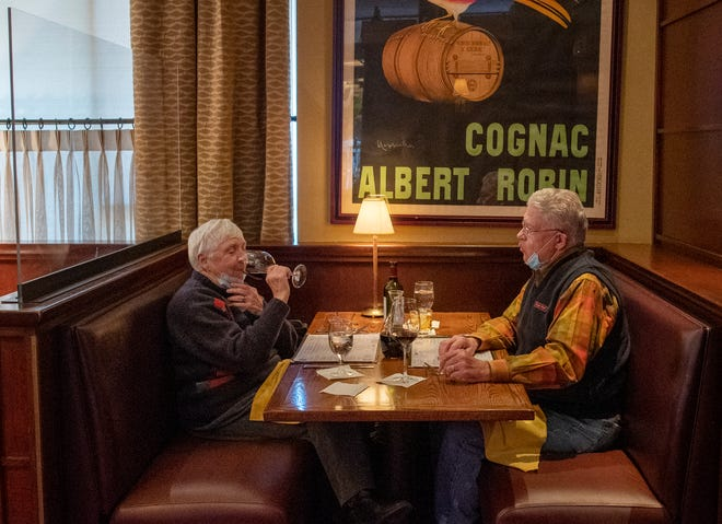 Beverly and Joe Maksin of Sutton sit down to dinner Friday in a booth at One Eleven Chop House in Worcester.