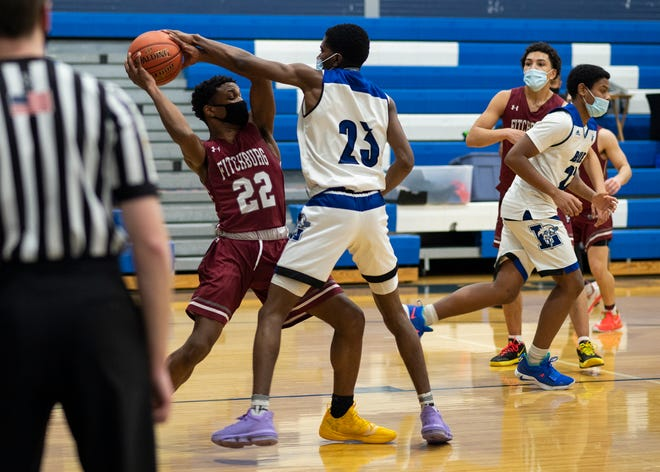 Fitchburg's Zion Ayala (22) looks for the open man during a game against Leominster last month.