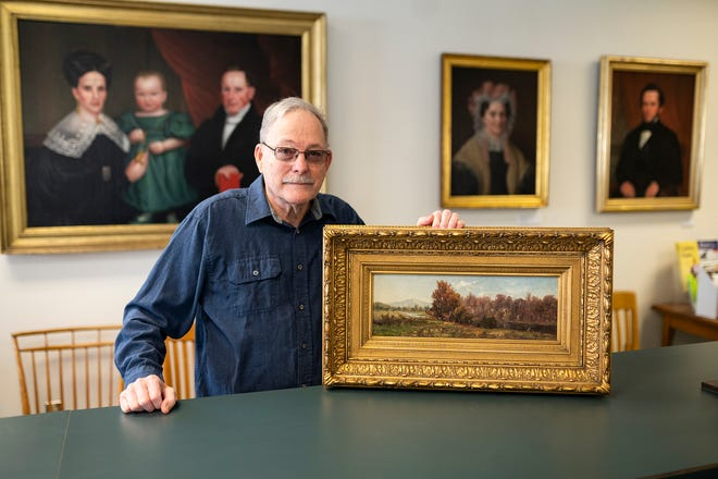 """Leonard Haug recently published a book about the Gamaliel Waldo Beaman's life titled """"Gamaliel Waldo Beaman - His Life and Art."""" Haug shows off a piece from his personal collection at the Forbush Memorial Library in Westminster on Friday, Jan. 29, 2021"""