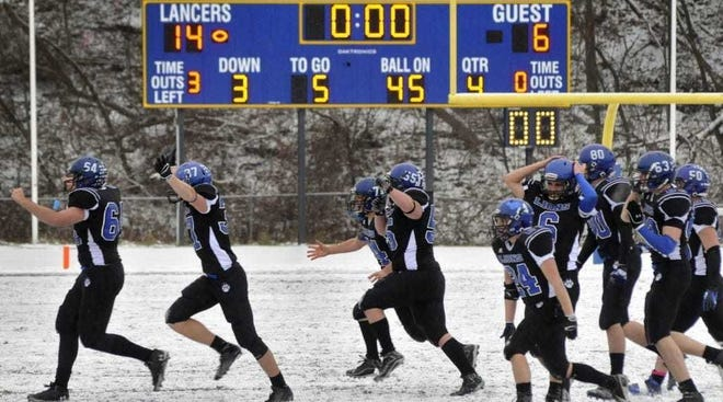 West Boylston players storm a snow-covered field to celebrate a Super Bowl title in 2012. The MIAA on Friday approved safety modifications for football and other fall sports that will begin in the late-winter chill of February due to the pandemic.