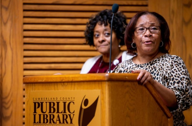 Barbara Carraway, right, speaks during an AIDs awareness forum that is part of a Community Conversations event in December of 2019 at the Cumberland County Public Library. Carraway has taken the COVID-19 vaccine, but she says she has seen in the Black community skepticism of the government that is similar to what she saw with the AIDS/HIV crisis.