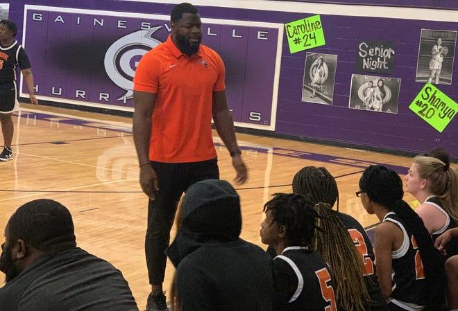 Hawthorne girls basketball coach Cornelius Ingram talks to his team Thursday.