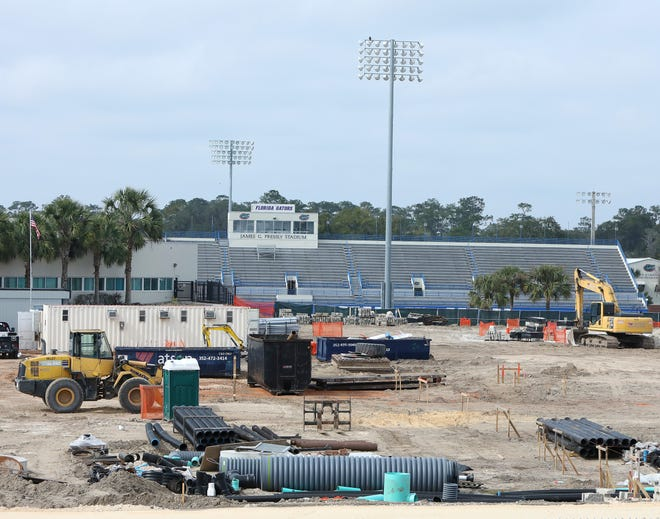 Construction crews work on the site of the new University of Florida Football Training Facility where McKethan Stadium once stood on the UF campus.