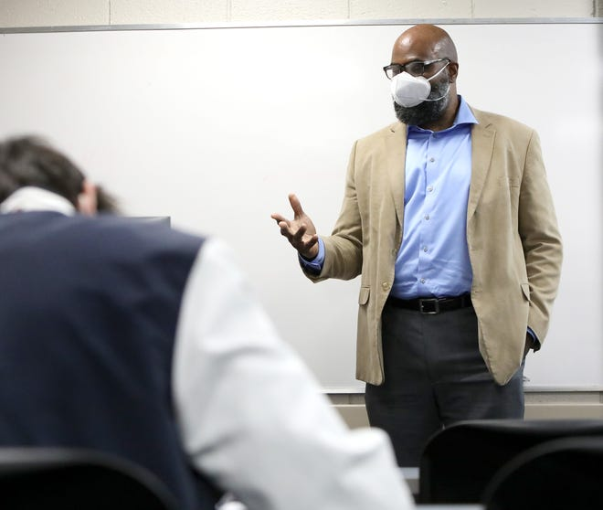 David Canton, director of the African-American Studies Program at the University of Florida, teaches his class called History of Hip-Hop on campus on Jan. 20. The University of Florida has made a commitment to hiring a more diverse faculty.