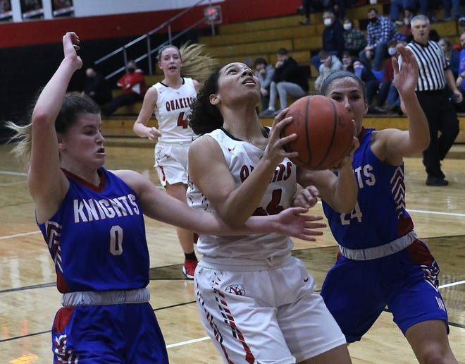 New Philadelphia's Ajia Schreffler gets set to shoot as West Holmes Alicia Alexander and Claire Reynolds defend Thursday.