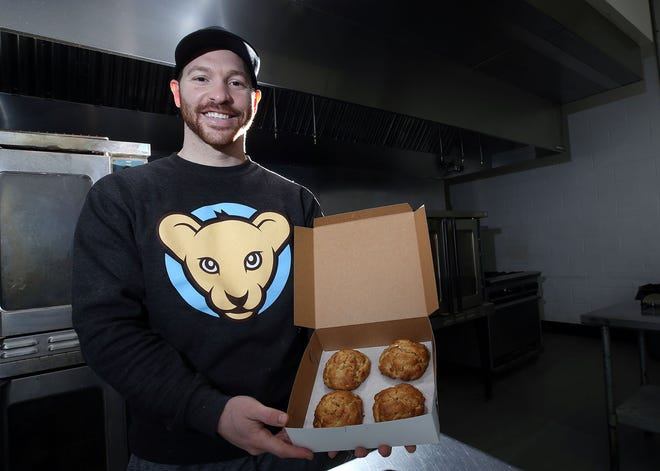 Bradley Kaplan, owner of Lion Cub's Cookies, displays a box of some of his peanut butter cookies. Lion Cub's Cookies currently is delivery only but will open a shop this spring at 1261 Grandview Ave. in Grandview Heights.