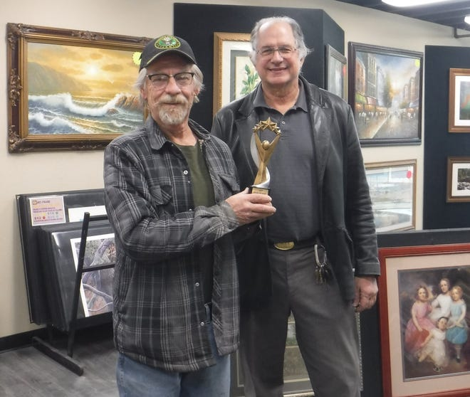 Daily Press letter writer Marty Torok (left) accepts his 2020 High Desert Liberal Award from Byron Ward, owner of HD Art N Frame in Victorville.
