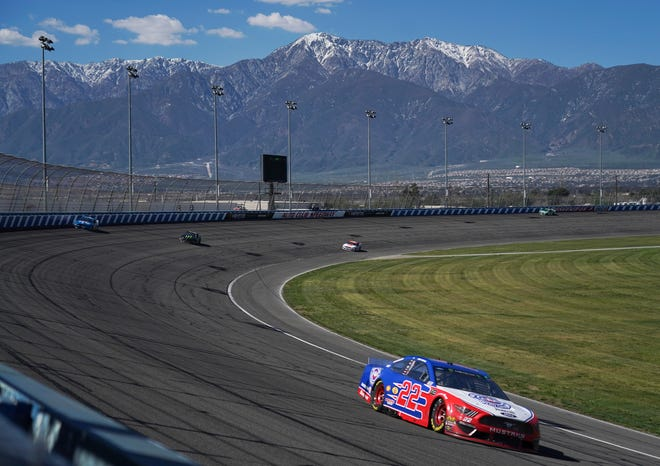 """Drivers race during the NASCAR Cup Series at Auto Club Speedway in Fontana on March 17, 2019. The speedway will be used as a COVID-19 vaccination """"super site"""" on Tuesday, Feb. 2, 2021."""