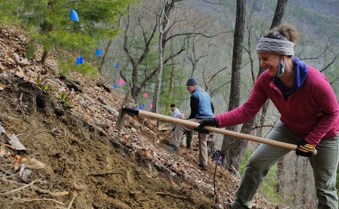 Abbey Malk, Wild South volunteer, works on the part of the new Leadmine Trail descending to the Linville River in the Linville Gorge last fall.