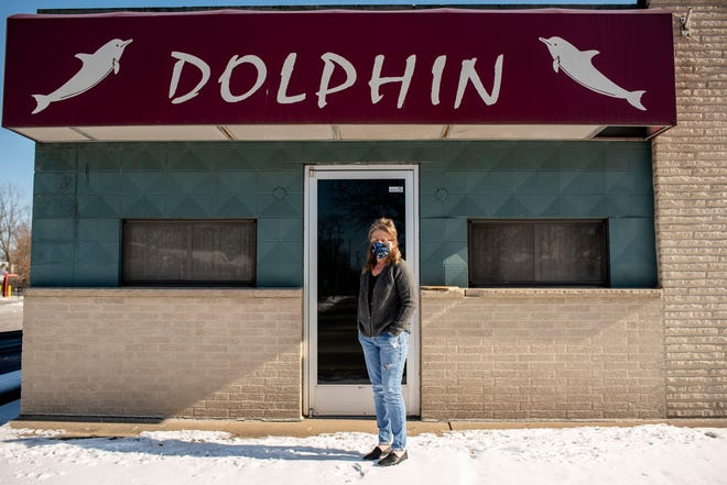 Lori Leiter, who owns the Dolphin Lounge with her husband Kevin Leiter, stands for a portrait outside of their bar on Friday, Jan. 29, 2021 in Battle Creek, Mich.