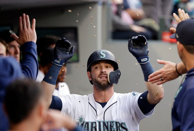 FILE - Seattle Mariners' Mitch Haniger is congratulated and showered with sunflower seeds after his solo home run against the Houston Astros in the third inning of a baseball game in Seattle, in this Tuesday, June 4, 2019, file photo. Mitch Haniger never saw the field in 2020 for the Seattle Mariners. He barely saw the field in 2019. He's nearly three years removed from being an All-Star, but the Mariners believe that with Haniger now full healthy he can once again be that caliber of player. (AP Photo/Elaine Thompson, File)