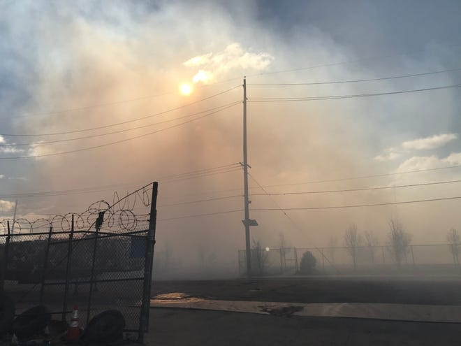 Smoke blots out the morning sun at the site of a refuse fire in South Camden in January. The smoke forced residents from their homes and the odor traveled several miles. A South Camden nonprofit is expanding its mission to help residents advocate for environmental justice.