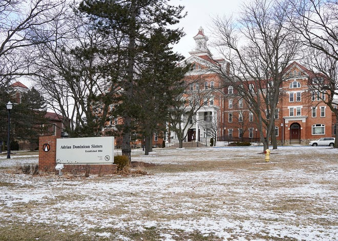 This photo shows the motherhouse of the Adrian Dominican Sisters Thursday, Jan. 28, 2021, in Adrian, Mich. Nine Roman Catholic nuns in southern Michigan have died in January due to a COVID-19 outbreak at their retirement home, which had gone for months without a single case, officials said Thursday.