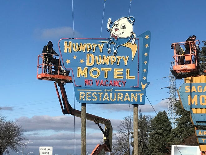 Finished Humpty Dumpty neon sign on Woodward Avenue in Pontiac. John Meyers and Don Krill operate articulating boom lifts for the construction department to get sign finished in the air once mounted. Brian Kelly, chairman of MFIA, which is trying to bring film incentives back to Michigan, worked on this film -- No Sudden Move -- by Steven Sodenberg --- filmed in Detroit for HBO MAX. He's hoping to lure more work with new incentives.